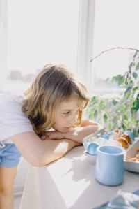 little girl staring at easter eggs